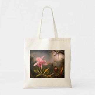 Orquídea rosada y la bolsa de asas de tres colibrí
