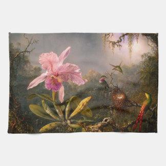 Orquídea y toalla de cocina rosadas de tres colibr