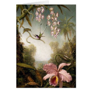 Orquídeas del aerosol con la tarjeta de nota del c