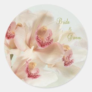 Orquídeas poner crema blancas en el boda de la pegatinas redondas