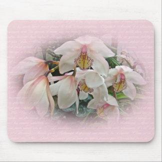 Orquídeas poner crema y rosadas tapete de ratón