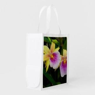 Orquídeas púrpuras rosadas amarillas de la puesta bolsas de la compra