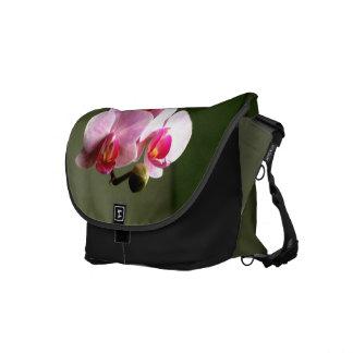 Orquídeas rosadas bolsas de mensajería