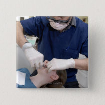 Orthodontist readjusting the dental braces of a button