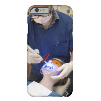 Orthodontist using UV light to set the concrete Barely There iPhone 6 Case