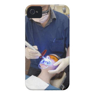 Orthodontist using UV light to set the concrete iPhone 4 Case-Mate Case