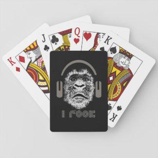 Oscilo los auriculares que llevan del gorila baraja de cartas