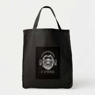 Oscilo los auriculares que llevan del gorila bolsa tela para la compra