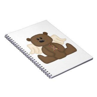 Oso de la conciencia del autismo del muchacho cuaderno