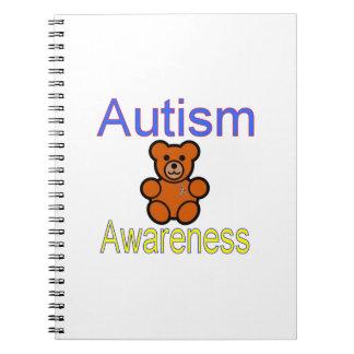 oso de peluche de la conciencia del autismo con la cuadernos
