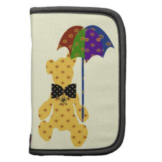 Oso de peluche lindo con el paraguas planificadores