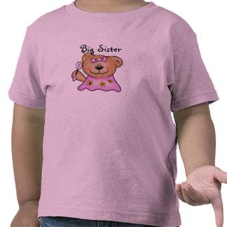Oso de peluche lindo de la hermana grande en rosa camiseta