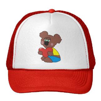 Oso de peluche triste con un gorra del corazón