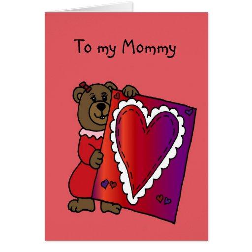 oso del chica que detiene a la tarjeta del día de