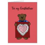 oso del muchacho que detiene a la tarjeta del día