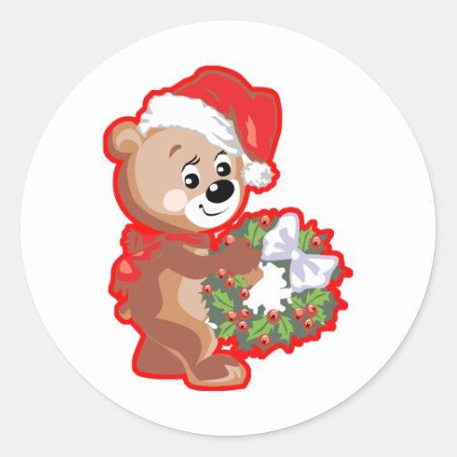 Oso del navidad con la guirnalda pegatina redonda