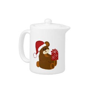 Oso del navidad en un gorra rojo de Santa