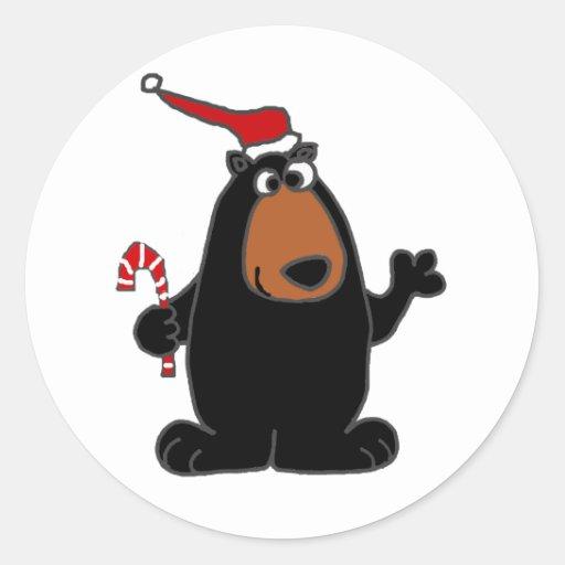 Oso negro divertido en arte del navidad del gorra pegatinas redondas