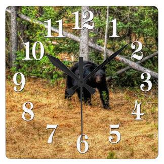 Oso negro salvaje y arte de la foto del bosque del reloj de pared