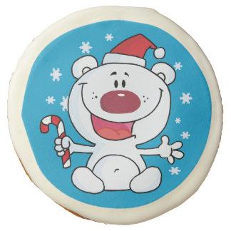 Oso polar con el bastón de caramelo