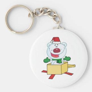 Oso polar del navidad haciendo estallar fuera de u llavero redondo tipo pin