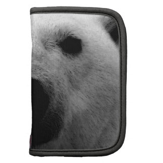 Oso polar negro y blanco planificadores
