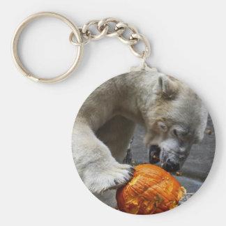 Oso polar que come una calabaza llavero