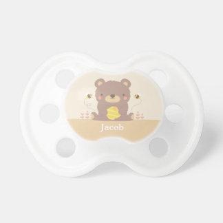 Oso y abejas lindos del arbolado para los bebés chupetes de bebé