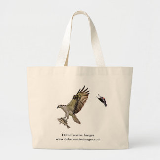 Osprey being chased by a red winged blackbird large tote bag