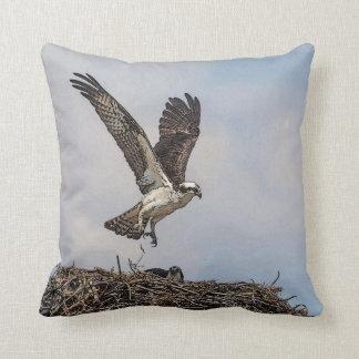 Osprey in a nest throw pillow