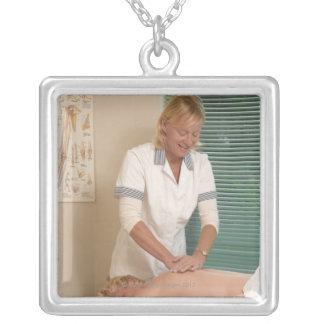 Osteopath chiropractor manipulating back custom jewelry