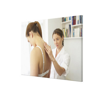 Osteopath treating patient. canvas print