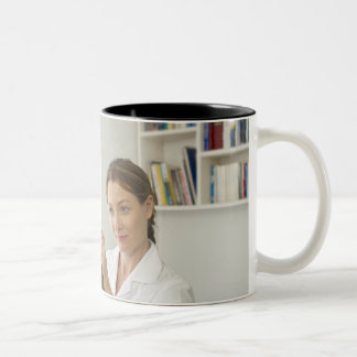 Osteopath treating patient. Two-Tone coffee mug