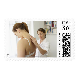 Osteopath treating patient. postage