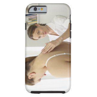Osteopath treating patient. tough iPhone 6 case