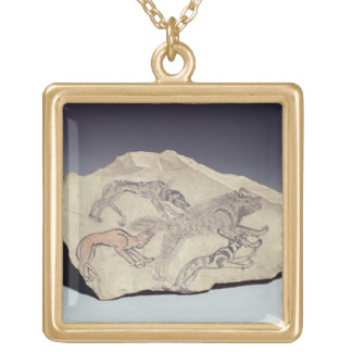 Ostracon depicting a dog chasing a hyena (limeston gold plated necklace