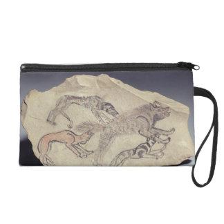 Ostracon depicting a dog chasing a hyena (limeston wristlet