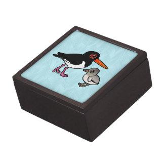 Ostrero de varios colores con el polluelo cajas de recuerdo de calidad