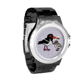 Ostrero de varios colores con el polluelo relojes