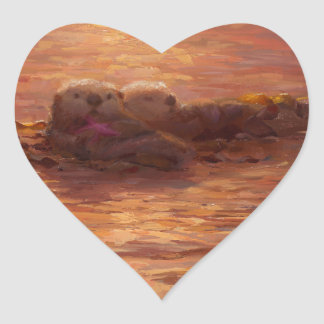 Otters Snuggling at Sunset Floating With Kelp Heart Sticker