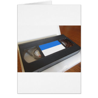 Outdated videocassette . Old video tape on a table Card