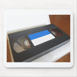 Outdated videocassette . Old video tape on a table Mouse Pad