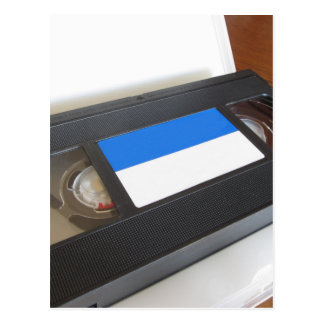 Outdated videocassette . Old video tape on a table Postcard