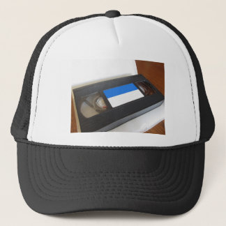 Outdated videocassette . Old video tape on a table Trucker Hat