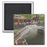 Outdoor cafe along River Walk and bridge over 2 2 Inch Square Magnet