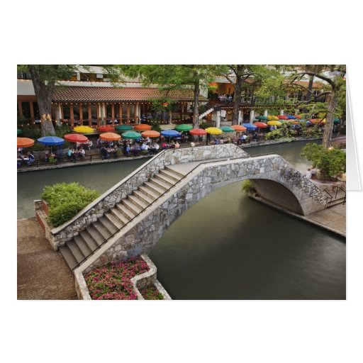 Outdoor cafe along River Walk and bridge over 2 Greeting Card