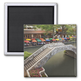 Outdoor cafe along River Walk and bridge over 2 Magnet