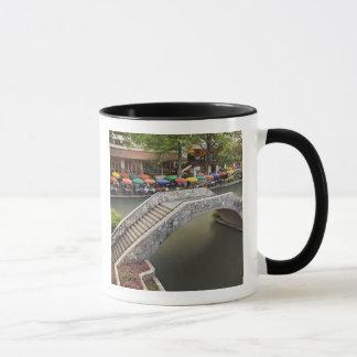 Outdoor cafe along River Walk and bridge over 2 Mug