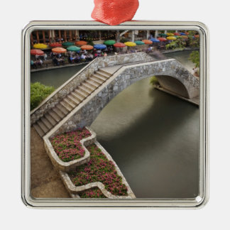 Outdoor cafe along River Walk and bridge over Metal Ornament