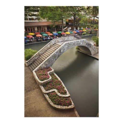 Outdoor cafe along River Walk and bridge over Photo Print